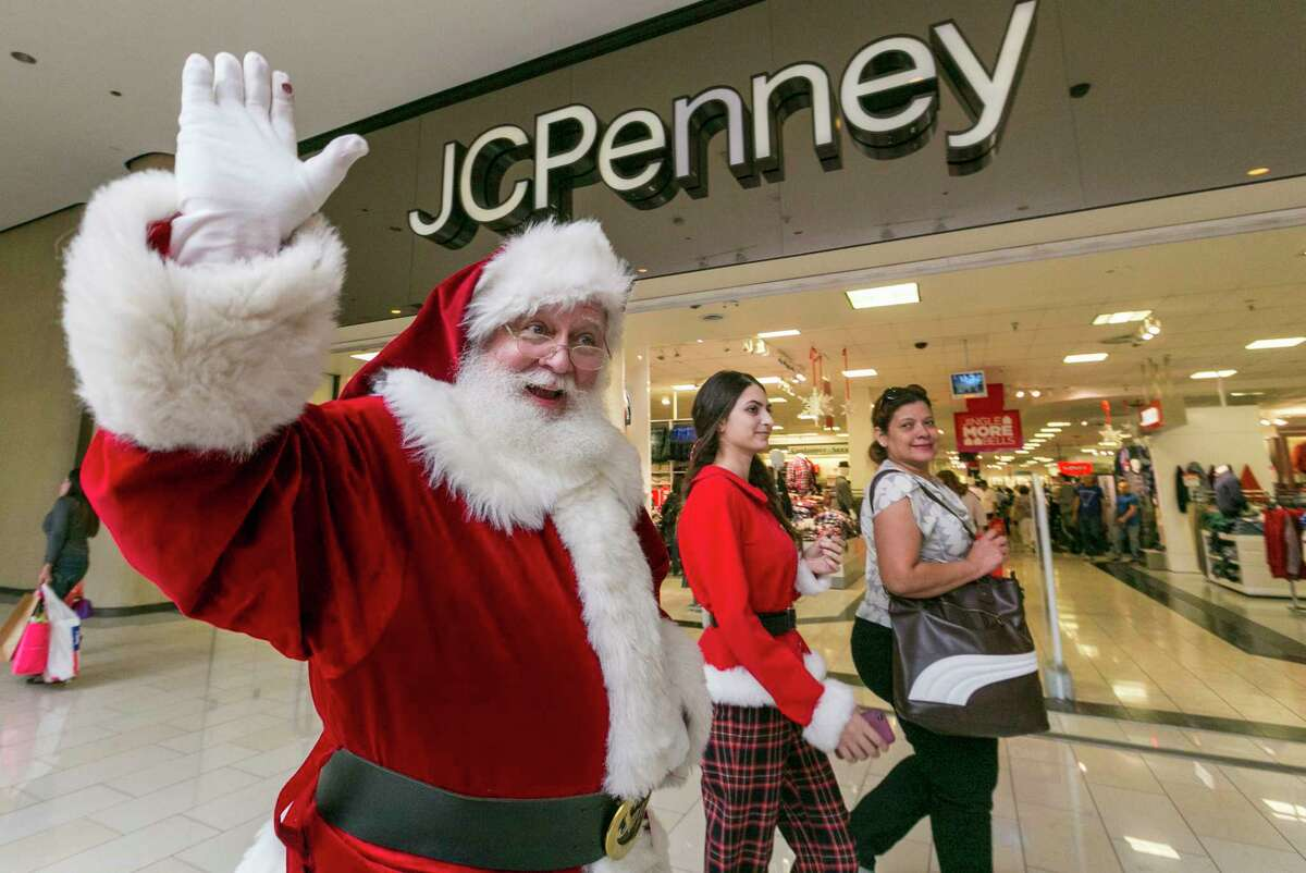 A man dressed as Santa Claus greets shoppers outside the JCPenney store at the Glendale Galleria shopping mall in Glendale, Calif.