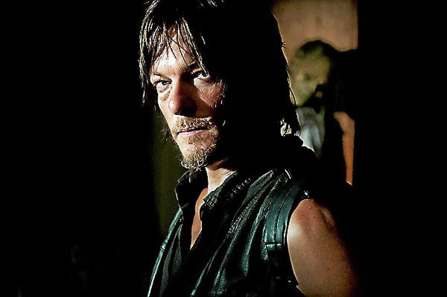 "Daryl Dixon (Norman Reedus) in ""The Walking Dead."" Photo: (Gene Page — AMC) / AMC Networks 2014"