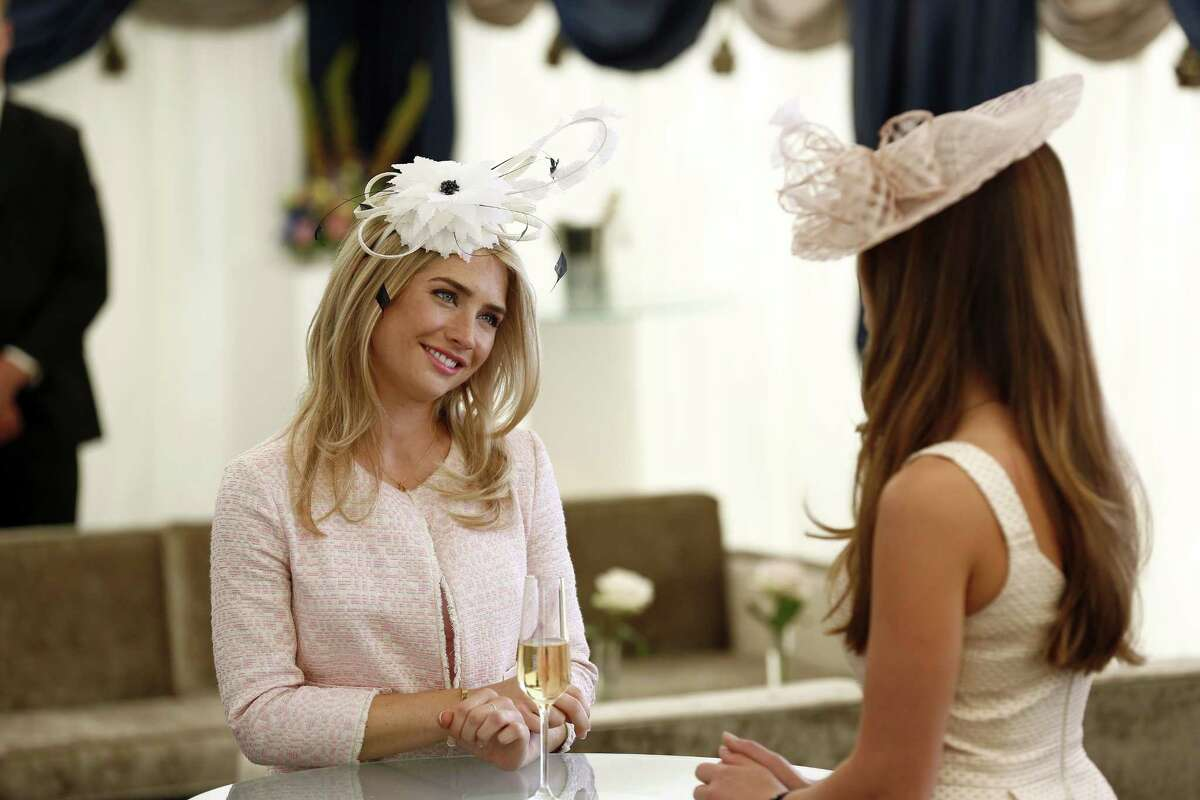 "Sophie Colquhoun, left, and Merritt Patterson in a scene from ""The Royals,"" a scripted series about the lives of a fictional royal family set in modern day London."