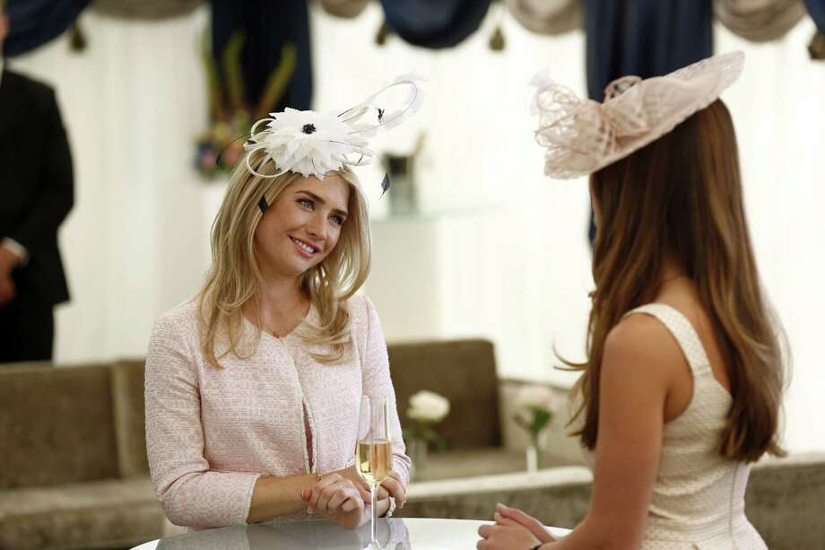 """Sophie Colquhoun, left, and Merritt Patterson in a scene from """"The Royals,"""" a scripted series about the lives of a fictional royal family set in modern day London. Photo: The Associated Press — E!, Tim Whitby  / E! Entertainment"""