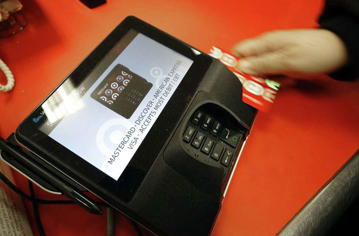 A shopper pays for her purchases at a Target store in South Portland, Maine.