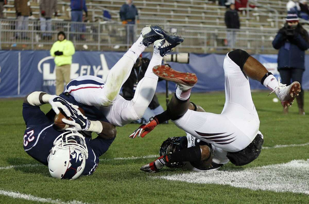 UConn safety Junior Lee hauls in an apparent interception on a pass to Cincinnati receiver Nate Cole during a Nov. 22 game in East Hartford. After review, the interception was nullified. Cincinnati won 41-0.