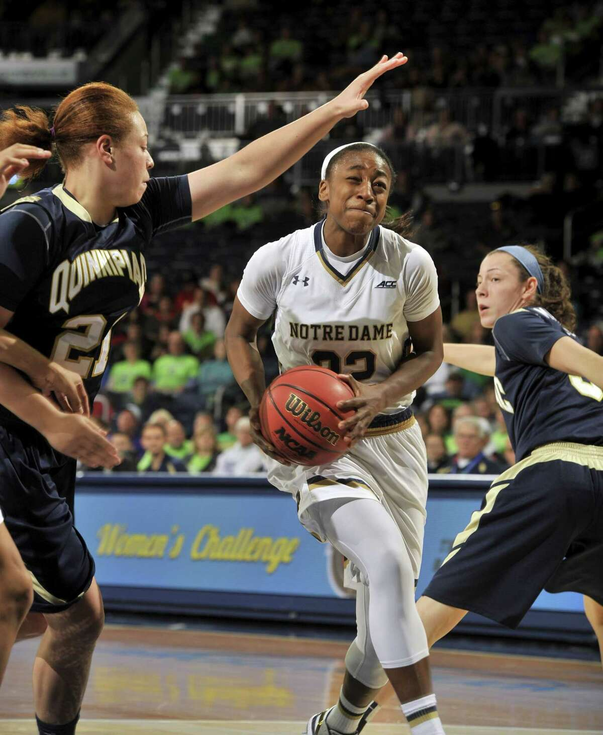 Notre Dame guard Jewell Loyd drives the lane between Quinnipiac guards Jennifer Fay, left, and Adily Martucci in the second half of a Nov. 25 game in South Bend, Ind.