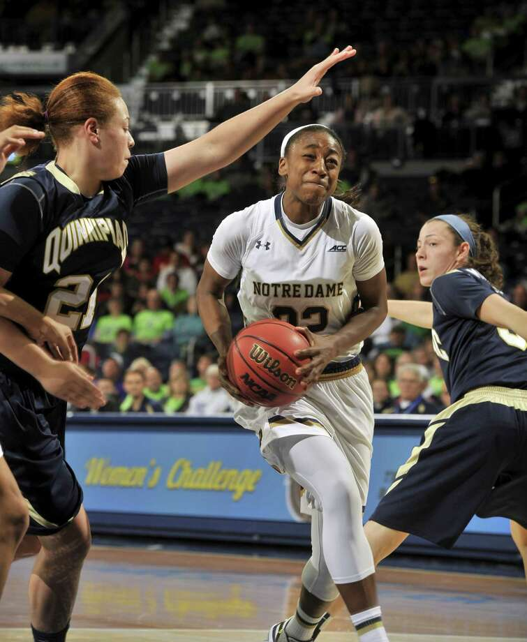 Notre Dame guard Jewell Loyd drives the lane between Quinnipiac guards Jennifer Fay, left, and Adily Martucci in the second half of a Nov. 25 game in South Bend, Ind. Photo: Joe Raymond — The Associated Press  / FR25092 AP