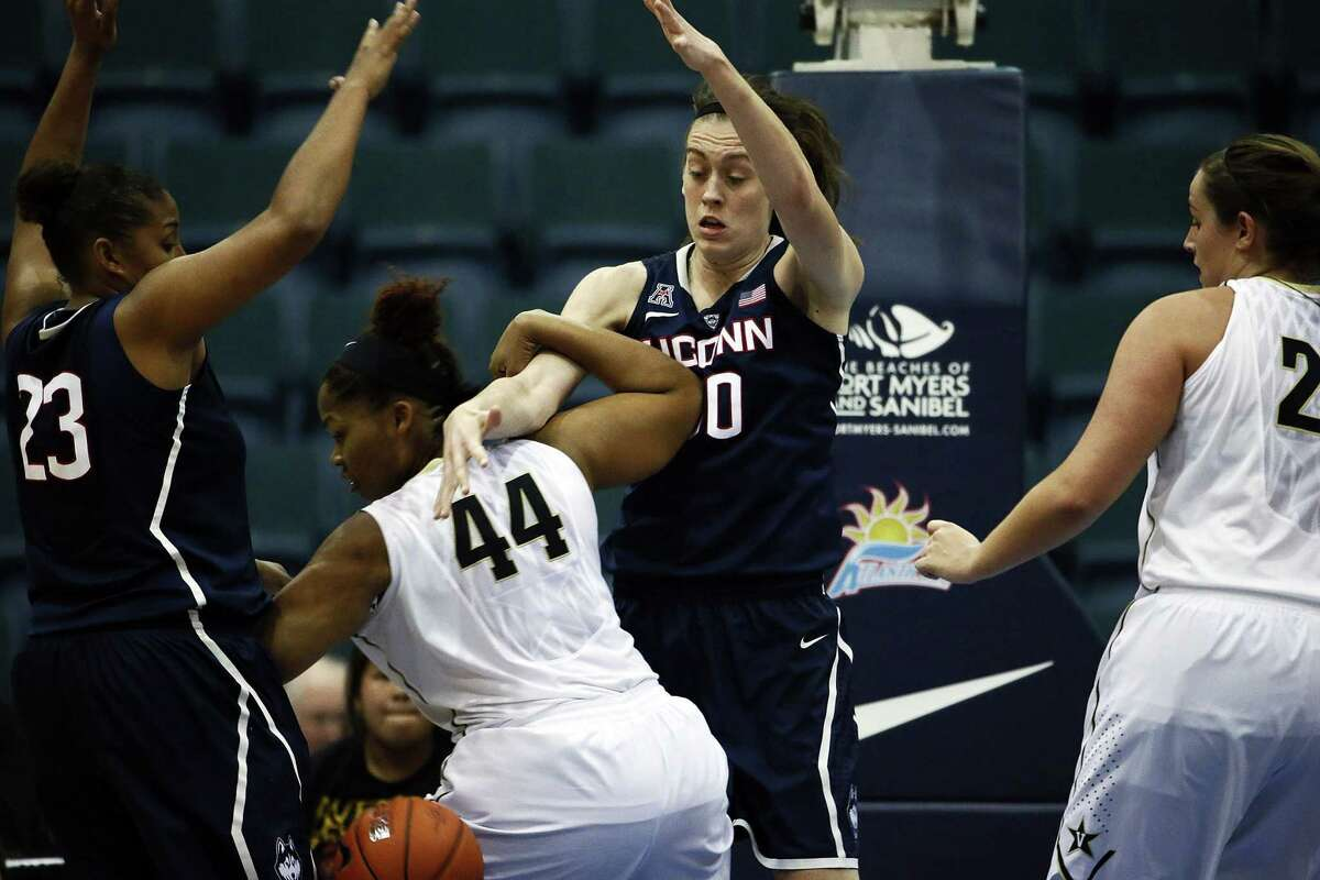 UConn's Breanna Stewart (30) bats the ball from Vanderbilt's Rayte'a Long (44) during the second half of Saturday's game in Estero, Fla.