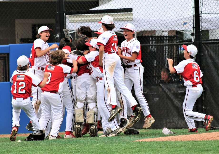 New England celebrates its 10-0 win over Maine in Little League Baseball Eastern Regional Tournament action in Bristol, Conn. on Saturday August 12, '17. Photo: Contributed Photo/Brian Roberts