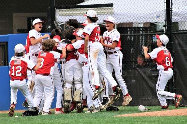New England celebrates its 10-0 win over Maine in Little League Baseball Eastern Regional Tournament action in Bristol, Conn. on Saturday August 12, '17.