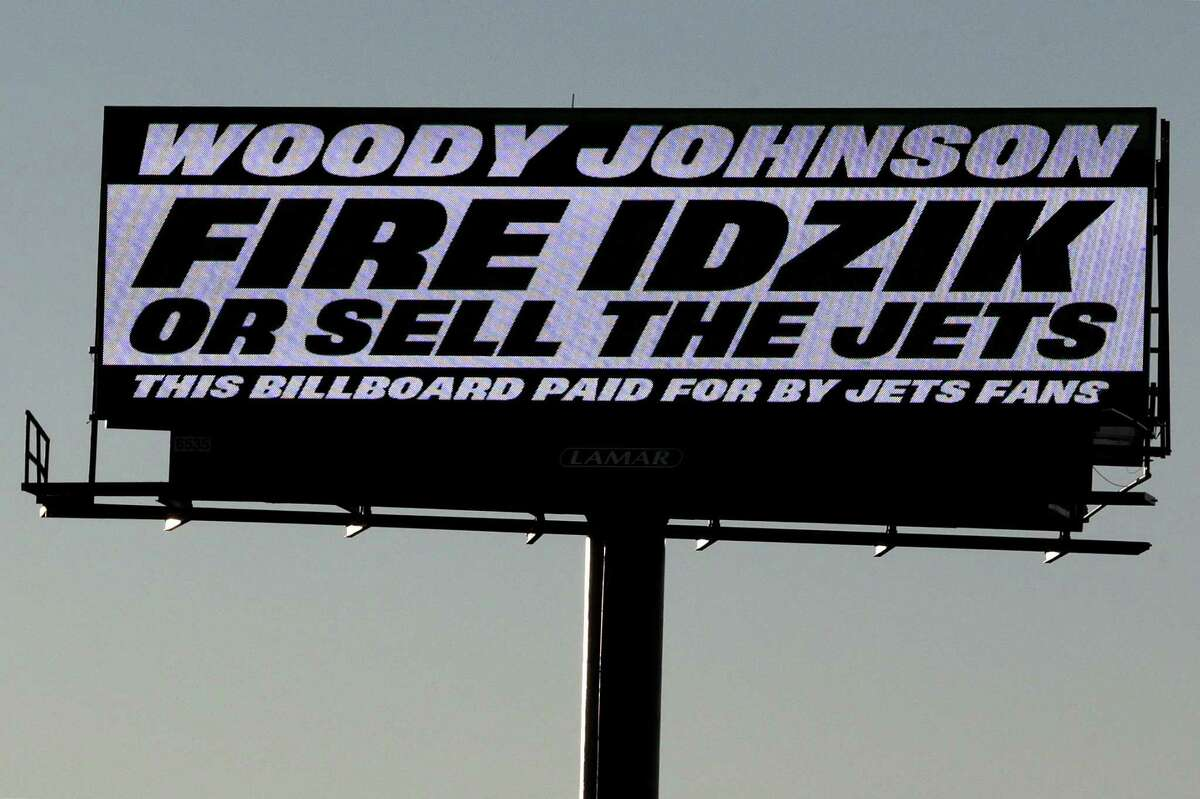 A sign directed at New York Jets owner Woody Johnson is seen on the side of Route 3 near MetLife Stadium on Nov. 28 in East Rutherford, N.J.