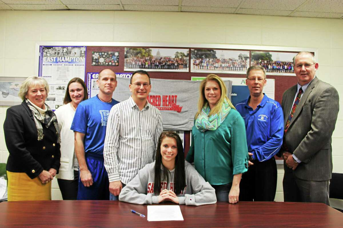 East Hampton's Hannah Cook recently signed a National Letter of Intent to attend and compete in track and field for Sacred Heart University in Bridgeport. Pictured with Cook, from left, are Diane Dugas(Superintendant), Caitlin Sullivan (Guidance Counselor), Shaun Russell(Athletic Director), parents James Cook and Kelley Matzek-Cook, Bill Wilkie (former East Hampton track coach), and John Fidler(principal).