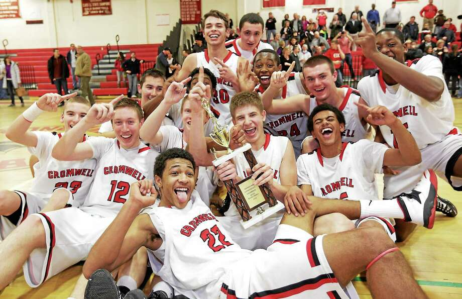 The Cromwell Boys Basketball team celebrate its victory in the 2014 Shoreline League Basketball championship against East Hampton. Photo: Photos By John Vanacore - Special To Middletown Press  / John Vanacore
