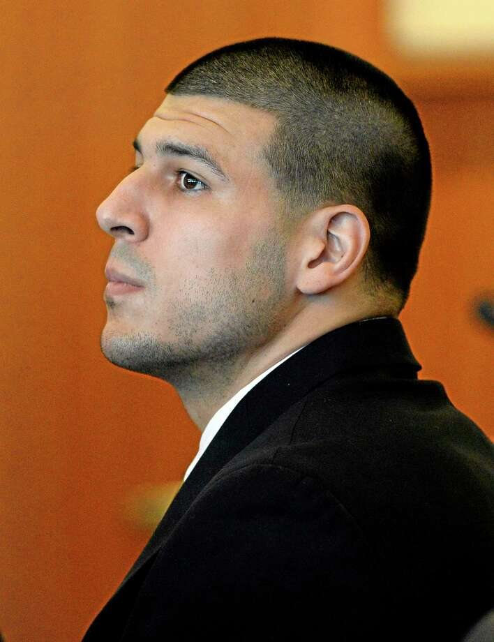 FILE - In this July 22, 2014, file photo, former New England Patriots' Aaron Hernandez watches during a hearing in Bristol County Superior Court in Fall River, Mass. The former New England Patriots player is due in court Thursday Aug. 14, 2014 for a pretrial hearing in the 2012 drive-by killings of two men outside a Boston nightclub in 2012. Suffolk County District Attorney Daniel Conleyís office says Thursday afternoonís hearing is ìpurely administrative in natureî as both sides prepare for a May 28, 2015 trial. (AP Photo/CJ Gunther, Pool, File) Photo: AP / Pool EPA