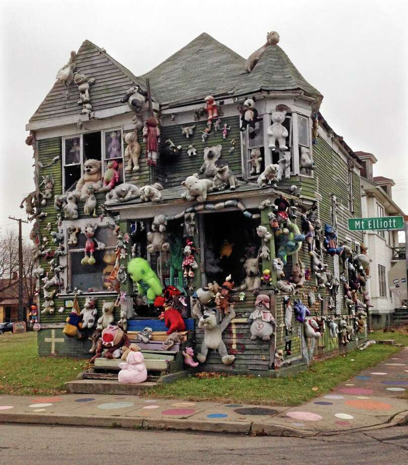 """In this Nov. 21, 2013 photo, stuffed animals are seen attached to """"The Party Animal House"""" in the Heidelberg Art Project in Detroit. Another fire has burned a house that's part of the outdoor art installation. WDIV-TV reports that the fire department responded early Friday, March 7, 2014 to the fire on the city's east side that destroyed the building. """"The Heidelberg Project has been the target of at least eight earlier suspicious fires. There have been no arrests related to the fires that started in May 2013, but local and federal officials are investigating. Tyree Guyton founded the east-side project in 1986 as a response to urban decay. (AP Photo/Carlos Osorio) Photo: AP / AP"""