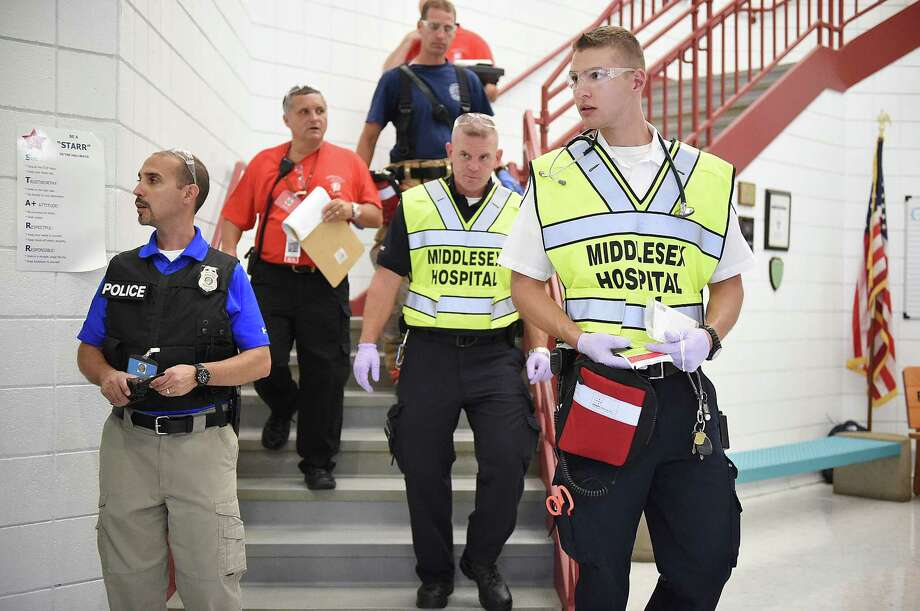 Last year, Middletown emergency personnel took part in a mock drill at Farm Hill Elementary School. City officials last week took part in a seminar about Multihazard Emergency Planning for Schools in Emmitsburg, Md. Photo: PRESS File PHOTO  / The Middletown Press
