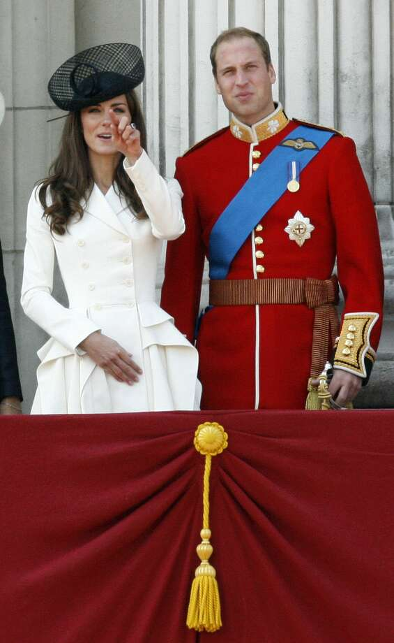 FILE - Britain's Prince William, Duke of Cambridge, right, his wife Catherine, Duchess of Cambridge, react on the balcony of Buckingham Palace after returning from the Trooping the Colour ceremony to mark the Queen's official birthday in London, in this, June 11, 2011 file photo. Among the roughly 5 million visitors expected in New York this holiday season, at least two are certain to get the royal treatment: Britainís Prince William and his wife, Kate. Theyíre due to arrive Sunday Dec. 7, 2014 for the first trip either has made to the United Statesí biggest city, and William also is set to visit the nationís capital for the first time. (AP Photo/Akira Suemori, File) Photo: AP / AP