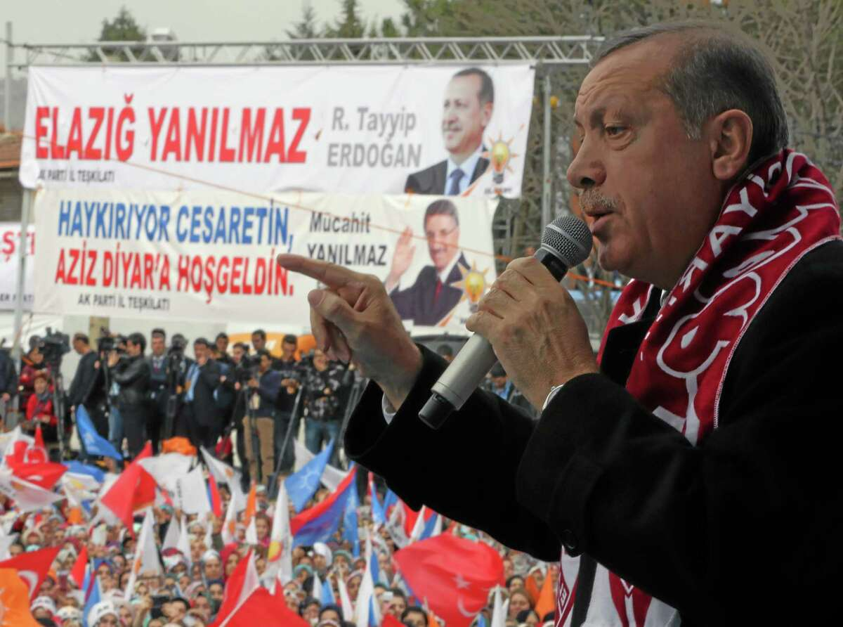 In this photo taken Thursday, March 6, 2014, Turkish Prime Minister Recep Tayyip Erdogan addresses a rally of his Justice and Development Party in Elazig, Turkey. Erdogan has threatened drastic steps to censor the Internet, including shutting down Facebook and YouTube, where audio recordings of his alleged conversations suggesting corruption have been leaked in the past weeks, dealing him a major blow ahead of this month's local elections.(AP Photo/Burhan Ozbilici) .