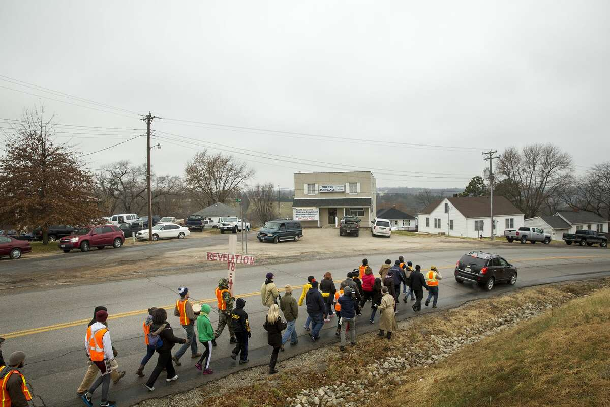 Members of the NAACP Journey for Justice weeklong march from Ferguson to Jefferson City make their way through Linn, Mo., on their way to the Capitol, Thursday, Dec. 4, 2014. Protesters plan to arrive at Jefferson City around noon Friday and gather at a garden near the governor's mansion. (AP Photo/The Jefferson City News-Tribune, Kile Brewer)