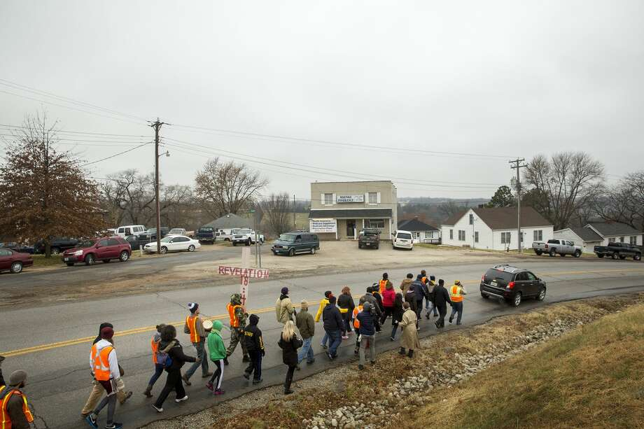 Members of the NAACP Journey for Justice weeklong march from Ferguson to Jefferson City make their way through Linn, Mo., on their way to the Capitol, Thursday, Dec. 4, 2014.  Protesters plan to arrive at Jefferson City around noon Friday and gather at a garden near the governor's mansion.  (AP Photo/The Jefferson City News-Tribune, Kile Brewer) Photo: AP / The Jefferson City News-Tribune