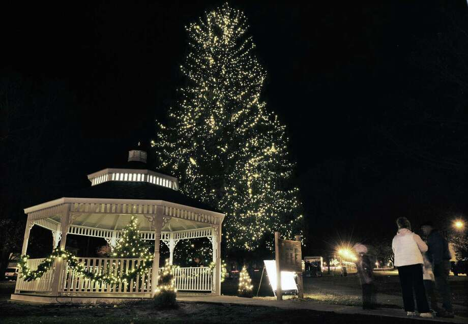 """The Holiday on Main Street in Middletown will kick off on the South Green with caroling at 5 p.m. by local school children and the annual tree-lighting ceremony at 5:45 p.m. The 85-foot tree is decorated with white lights and a small Christmas tree centered in the Veterans Memorial Gazebo is decorated by the Middlesex Hospital Hospice & Palliative Care """"shining a light in honor or in memory of friends and loved ones."""" Catherine Avalone - The Middletown Press Photo: Journal Register Co. / TheMiddletownPress"""
