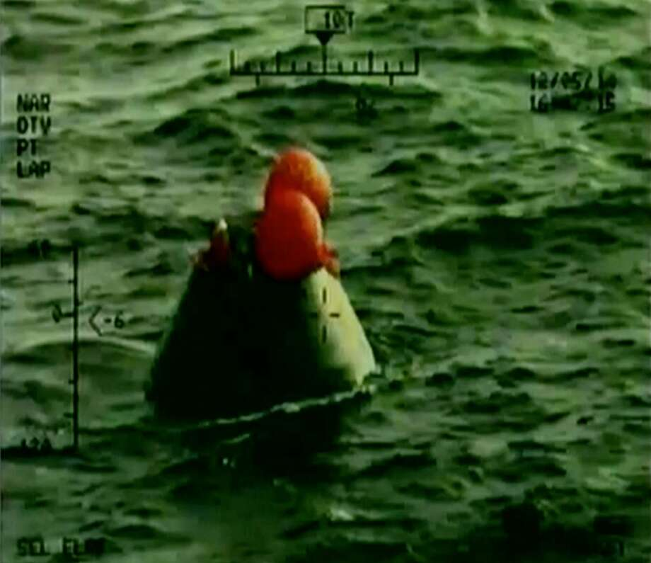 In this frame grab from NASA-TV, the Orion capsule floats after splashing down in the Pacific Ocean, Friday, Dec. 5, 2014, following a dramatic test flight that took it to a zenith height of 3,600 miles and ushered in a new era of human exploration aiming for Mars. (AP Photo/NASA) Photo: AP / NASA