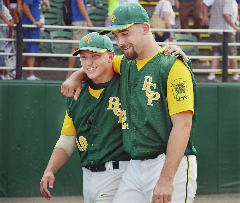 RCP's Christian Budzik, at left and Tommy Seaver celebrate following their 7-2 win over Post 75 Middletown in the semi final game of the American Legion Baseball Northeast Regional Tournament at William Pomfret Stadium at Palmer Field. Photo: Catherine Avalone - The Middletown Press