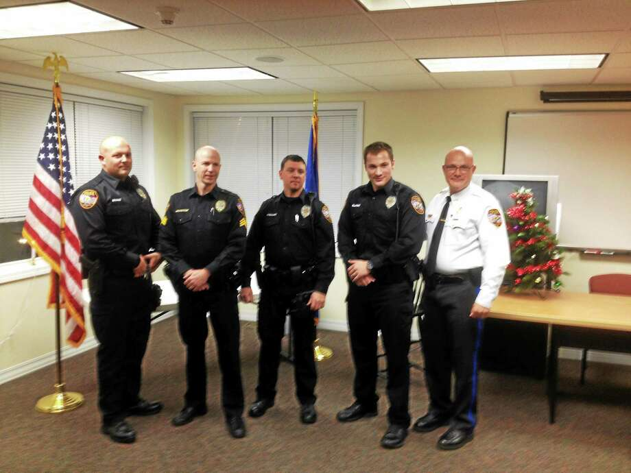 From left are: East Hampton police officer Adam Brault, Sgt. Jared Boynton, officers Jason Wishart and Hardie Burgin; and Police Chief Sean Cox. Photo: Jeff Mill — The Middletown Press