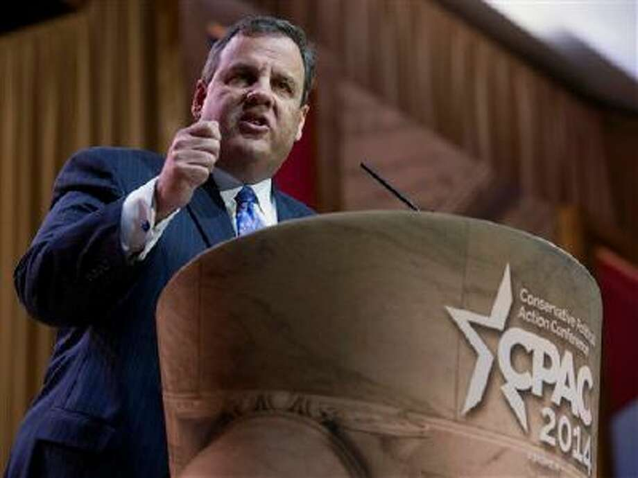 """New Jersey Gov. Chris Christie speaks at the Conservative Political Action Committee annual conference in National Harbor, Md., Thursday, March 6, 2014. Christie, facing conservatives who have been slow to embrace him, received applause throughout a speech that highlighted his opposition to abortion and stressed the importance of getting results. """"We don't get to govern if we don't win,"""" Christie said. (AP Photo/Cliff Owen) Photo: AP / FR170079 AP"""