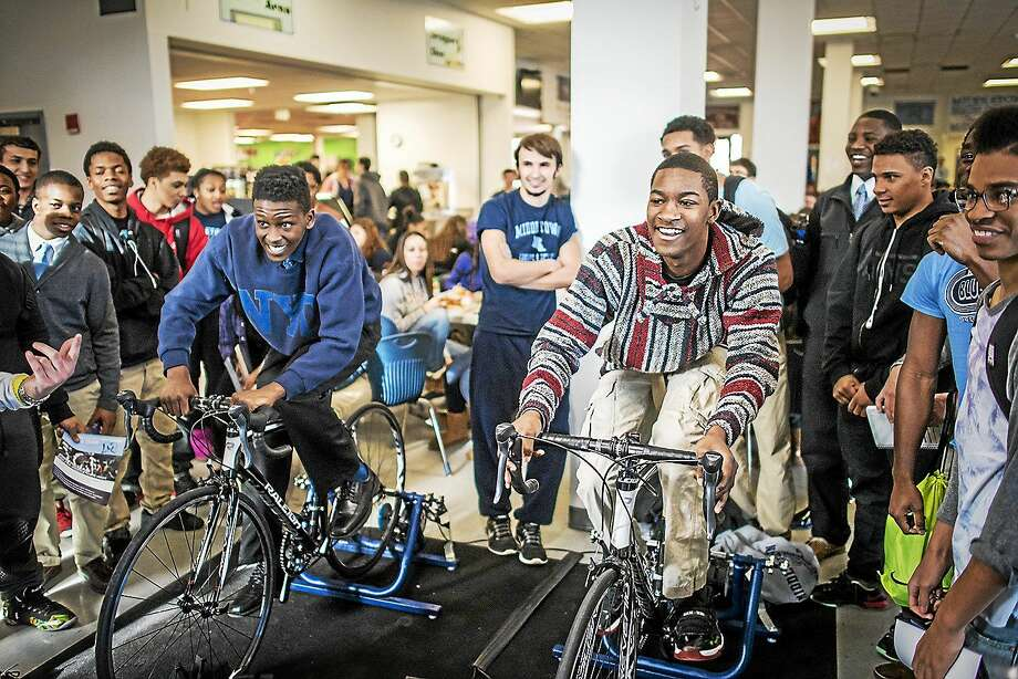 Contributed photos Lebrone Woodbury, 15, left, and Justin McMillan, 16, right, are sophomores at Middletown High School at a Computrainer event at MHS. Photo: Journal Register Co.