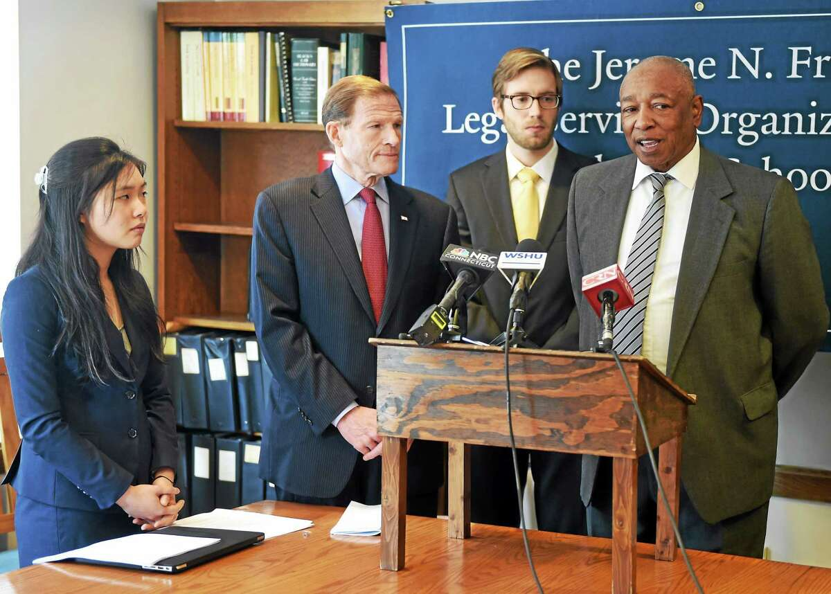 (Peter Hvizdak - New Haven Register) U.S. Marine Corp veteran, Conley F. Monk, Jr. of New Haven, 66, a Vietnam War combat veteran, far right, speaks during a press conference Monday morning, April 6, 2015 at the Yale University Law School in New Haven, Conn. where law student interns of the Yale Law School Veterans Legal Services Clinic announced the filing of a class action lawsuit in the U.S. Court of Appeals for Veterans Claims on behalf of Monk and other veterans with disability compensations appeals to get the Department of Veterans Affairs to deal with the cases quickly when a veteran faces medical or financial hardship. With Monk, from left, are Julia Shu, left, and Will Hudson, third from left, Yale Law School student interns at the Yale Law School Veterans Legal Services Clinic and U.S. Senator Richard Blumenthal, (D-CT).