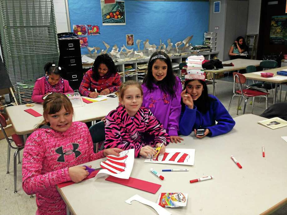 Farm Hill Elementary's Family Literacy Night brought 64 students and their parents to the school to celebrate Dr. Seuss and reading. Photo: Submitted Photo