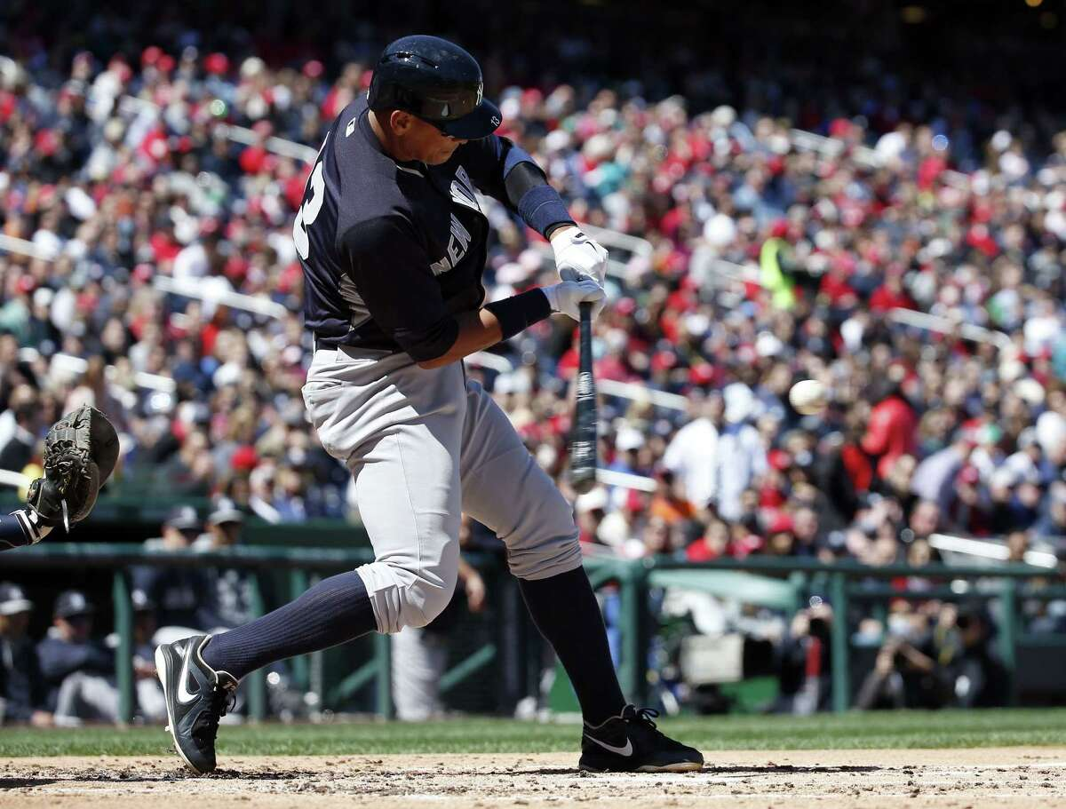 New York Yankees designated hitter Alex Rodriguez (13) fouls a ball away during the third inning of an exhibition baseball game against the Washington Nationals at Nationals Park, Saturday, April 4, 2015, in Washington. (AP Photo/Alex Brandon)