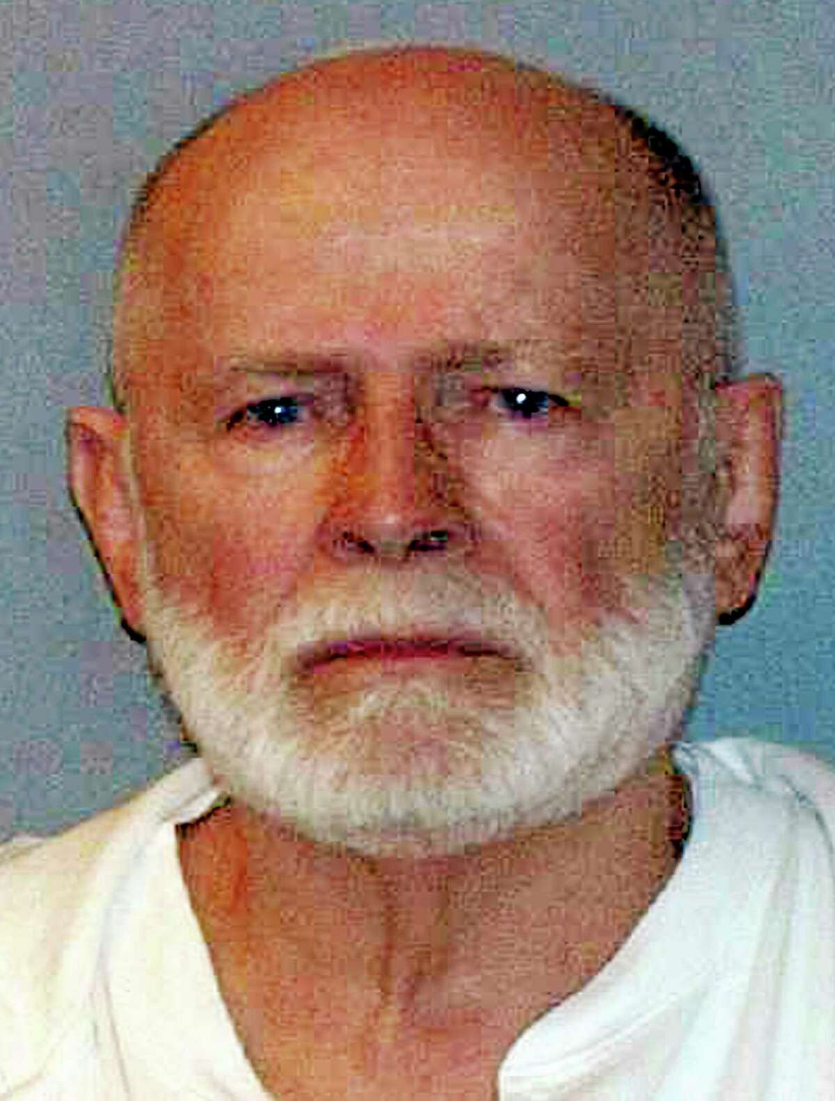 """FILE - This June 23, 2011 file photo shows a booking photo provided by the U.S. Marshals Service shows James """"Whitey"""" Bulger, captured in Santa Monica, Calif., after 16 years on the run."""