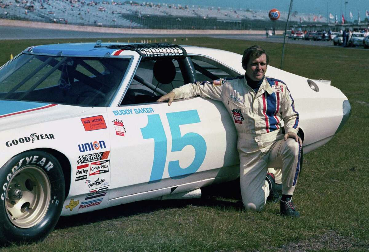 This is a 1975 file photo showing race car driver Buddy Baker at Daytona Speedway in Daytona Beach, Fla. Buddy Baker, a former Daytona 500 winner and NASCAR Hall of Fame nominee, died after a brief battle with lung cancer. Baker was 74.