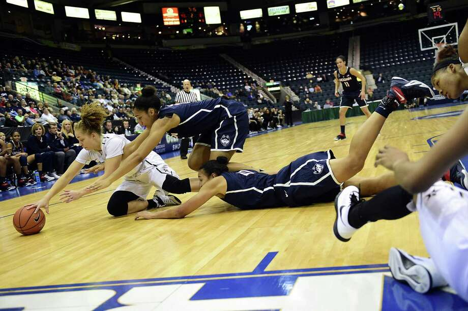 From left, Vanderbilt's Jasmine Jenkins and UConn's Gabby Williams and Kiah Stokes dive for a loose ball during a Nov. 28 game in Estero, Fla. Photo: Corey Perrine — Naples Daily News  / Naples Daily News