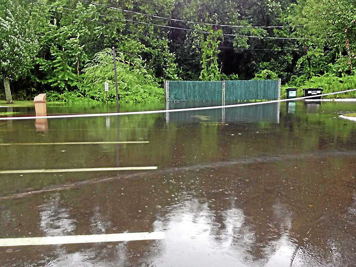 The parking lot of a Dunkin' Donuts store in Branford was roped off Wednesday morning because of flooding as severe storms pounded the state's coastline.