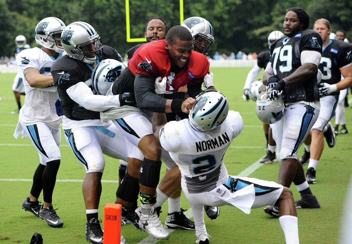 Carolina Panthers quarterback Cam Newton (1) and cornerback Josh Norman (24) scuffle during training camp on Monday at Wofford College in Spartanburg, S.C.