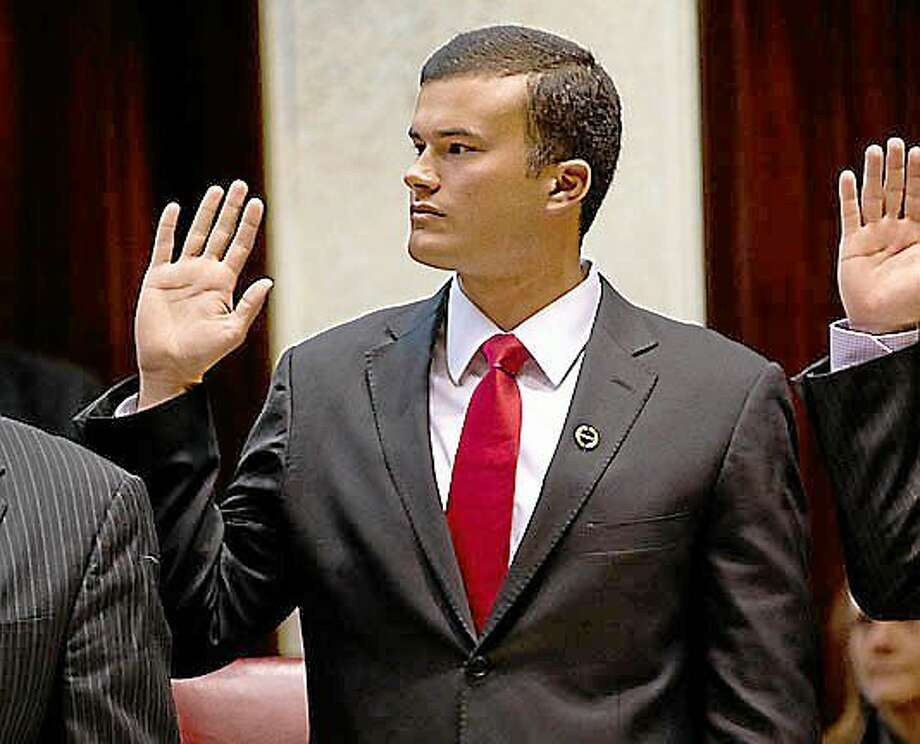 Submitted photo ¬ State Sen. Art Linares takes the oath of office on the first day of the 2013 session of the Connecticut General Assembly on Wednesday. Linares, 24, has received widespread media attention for winning office at such a young age. The Westbrook resident represents the 33rd Senate District, which encompasses Chester, Clinton, Colchester, Deep River, East Haddam, East Hampton, Essex, Haddam, Lyme, Old Saybrook, Portland and Westbrook. Linares has been named ranking member of the Connecticut General Assembly's Banks Committee and ranking member of the Select Committee on Children. Linares will also serve on the Commerce and Education Committees. His website is www.senatorlinares.com and he can be reached at (800) 842-1421. Photo: Journal Register Co.