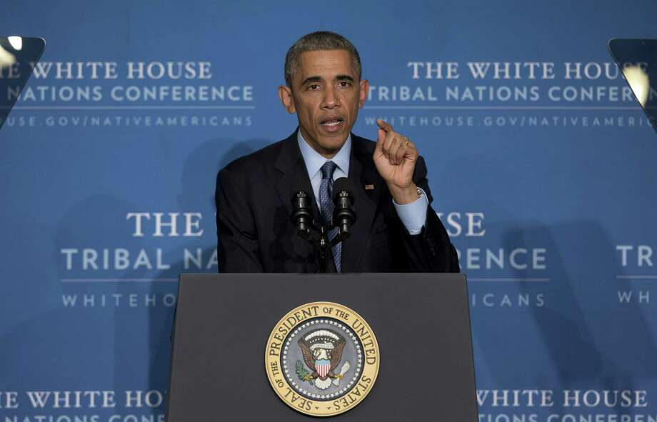 President Barack Obama speaks during the 2014 White House Tribal Nations Conference at the Capital Hilton in Washington on Wednesday. Photo: AP Photo  / AP