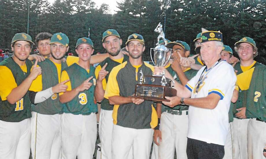 RCP coach T.J. Grande accepts the Northeast Regional championship trophy after Post 105 defeated Bristol Sunday at Muzzy Field. Photo: Photo By Jimmy Zanor -- The Middletown Press