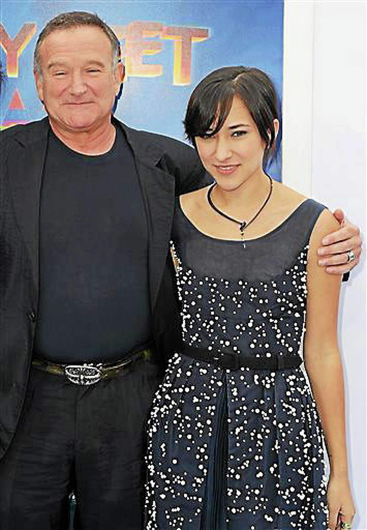 """This Nov. 13, 2011, file photo shows actor Robin Williams, left, and his daughter, Zelda, at the premiere of """"Happy Feet Two"""" in Los Angeles. AP Photo/Katy Winn, File"""