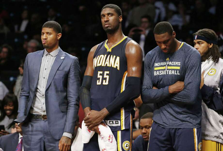 Indiana Pacers Paul George, left, Roy Hibbert (55) and teammates react in the waning seconds of a game against the Nets on Tuesday in Brooklyn. Photo: Kathy Willens — The Associated Press  / AP