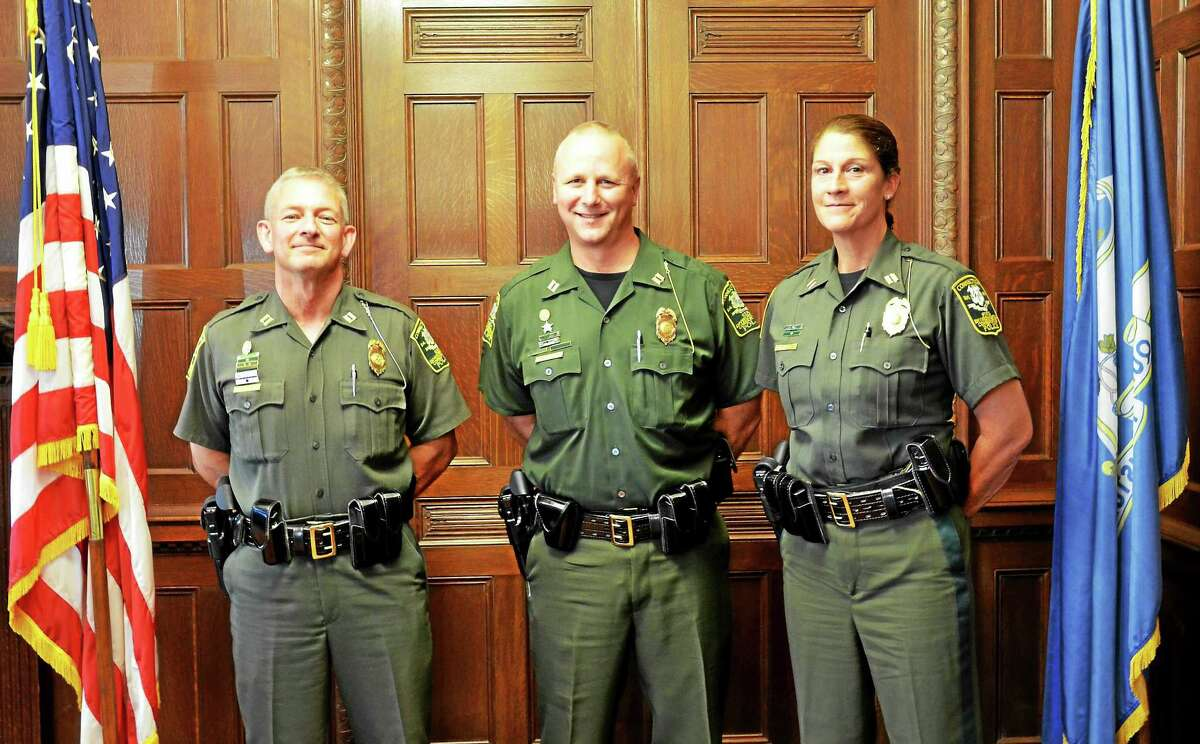 DEEP's Environmental Conservation Police have sworn in three new captains: from left, Eric Lundin of Killingworth, who will serve as commanding officer in the Eastern District; Jeff Samorajczayk of Shelton, who will serve as administrative captain in Hartford; and Cynthia Schneider of Westport, who will serve as commanding officer of the Western District.