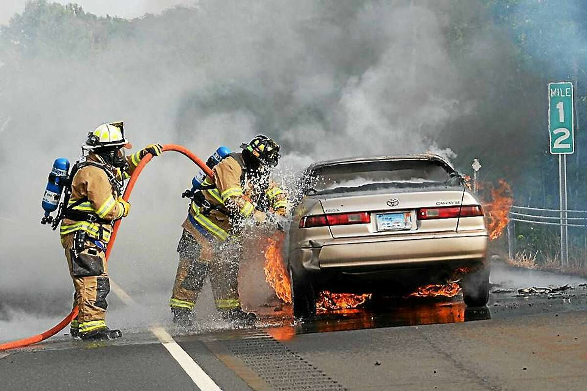 Haddam Volunteer Firefighters work to extinguish the flames.