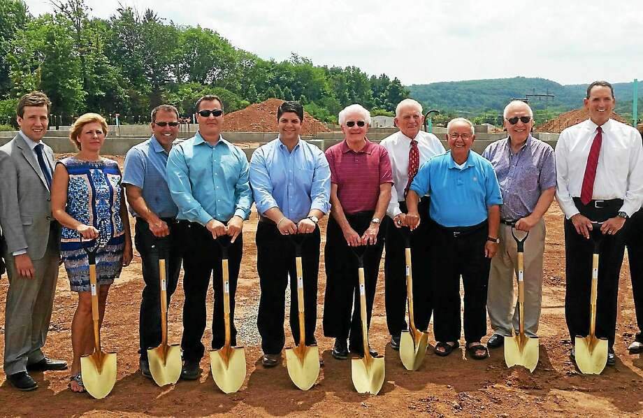 Middletown Mayor Daniel T. Drew recently held a ground-breaking ceremony to welcome two new businesses to Middletown. Construction for the new headquarter sites for Armani Restoration and Connecticut Mason Contractors has begun, officials said. Photo: Courtesy PHOTO