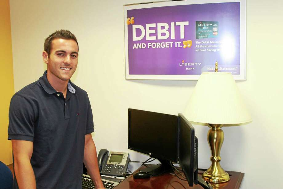 Alec Bogen, of Durham, is taking part this summer in the Middlesex Chamber of Commerce Summer Youth Employment Program, working at Liberty Bank. Photo: PHOTO COURTESY LORENZO MARSHALL
