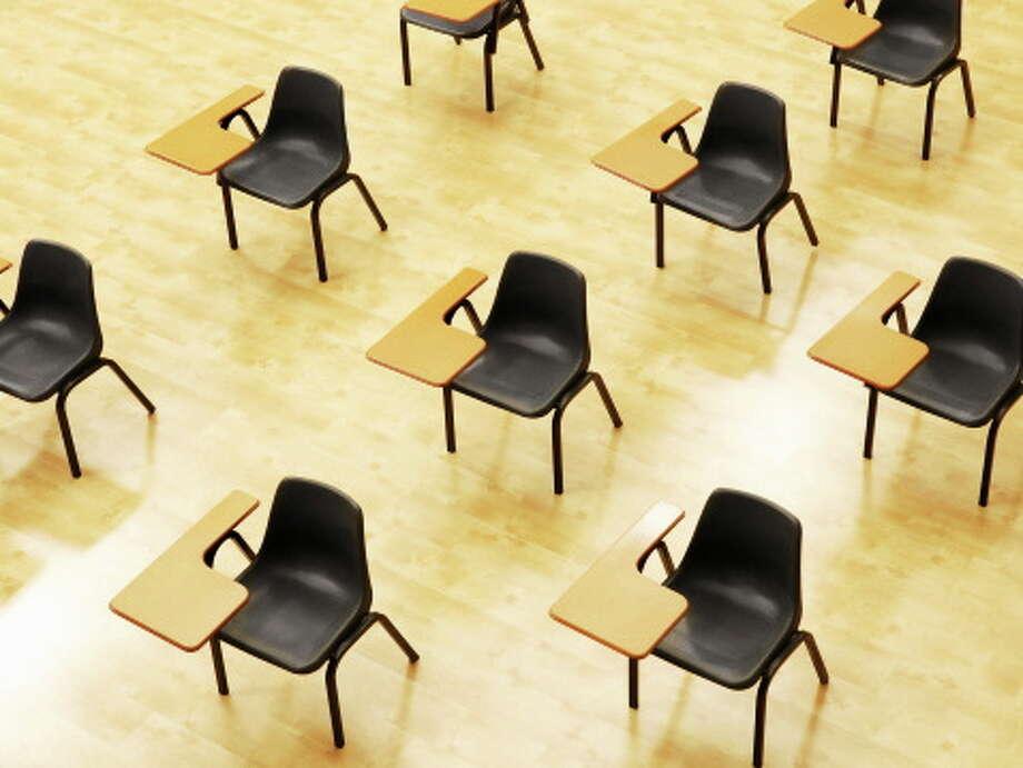 Desks in an empty classroom. Photo: DFM File Photo  / OJO Images RF