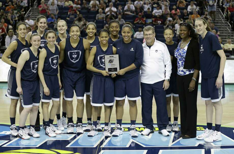 UConn poses for a photo after winning the NCAA Statistical Champion trophy for top field goal percentage on Saturday in Tampa, Fla. Photo: John Raoux — The Associated Press  / AP