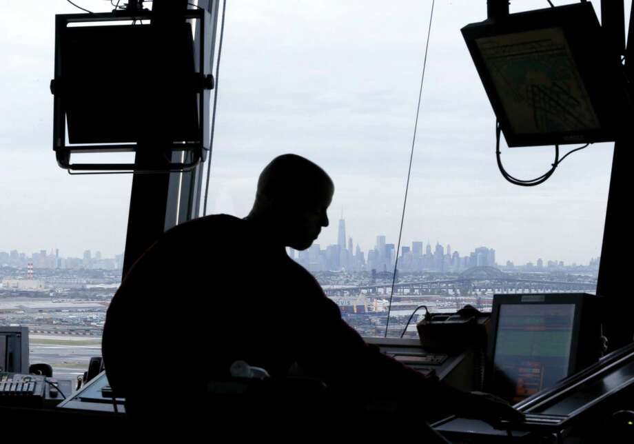 In this May 21, 2015 photo, an air traffic controller works in the tower at Newark Liberty International Airport in Newark, N.J. Photo: AP Photo/Julio Cortez, File  / AP