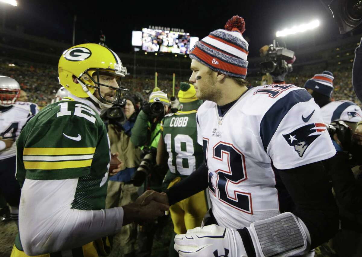 Packers quarterback Aaron Rodgers shakes hands with New England Patriots quarterback Tom Brady after Sunday's game in Green Bay, Wis.