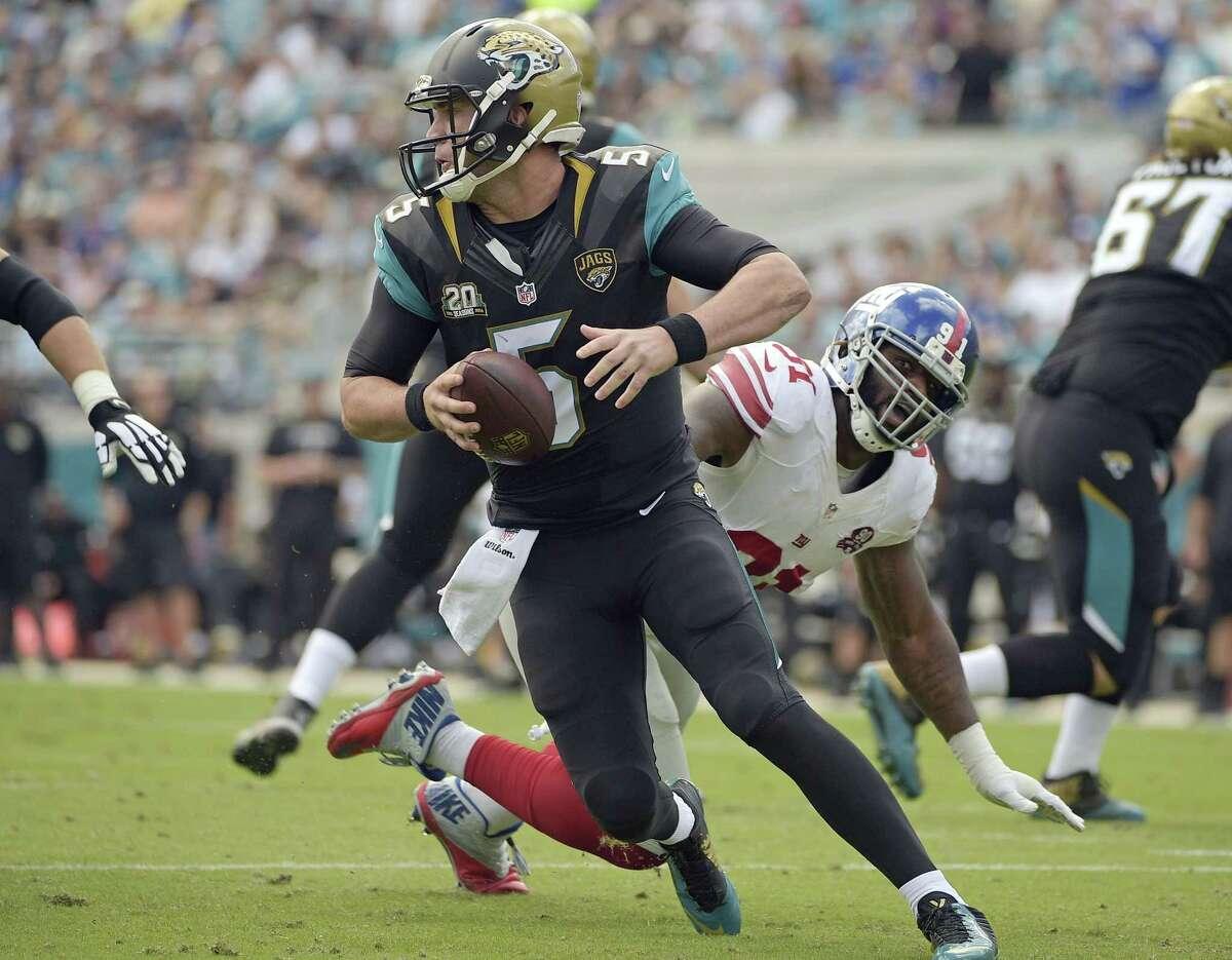Jaguars quarterback Blake Bortles scrambles away from New York Giants defensive end Robert Ayers during Sunday's game in Jacksonville, Fla.