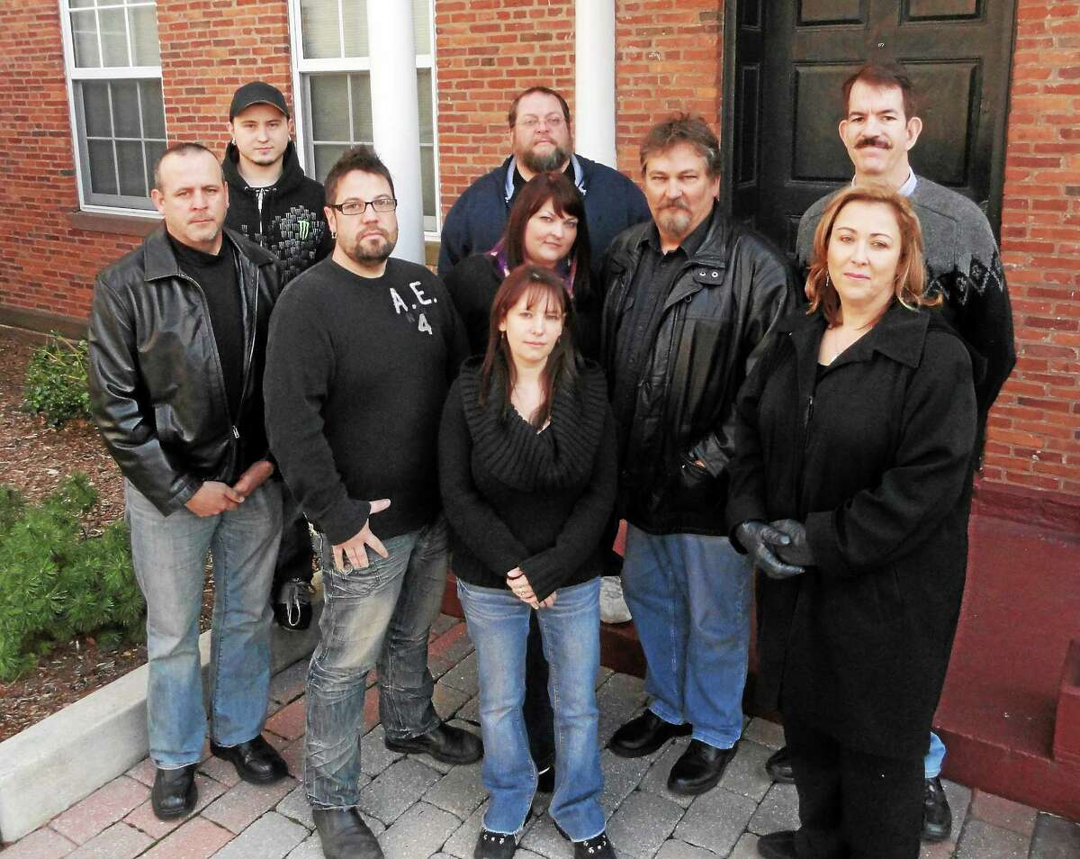 Members of the Ghosts of New England Research Society stand in front of the Armory in Middletown.